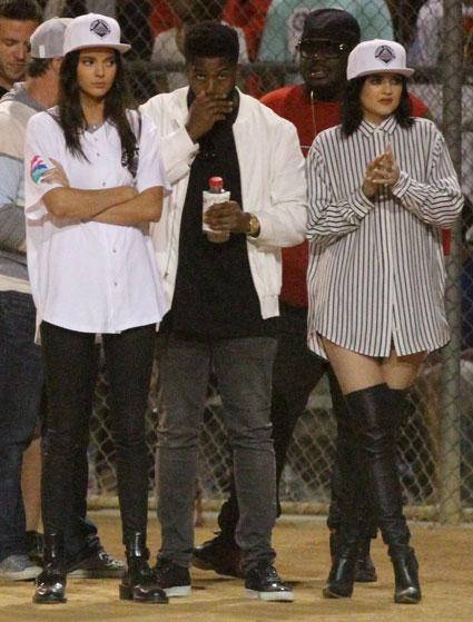 Striped Shirt, Daisy Dukes, Knee High Black Boots, White Snapback Hat